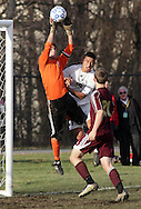Middletown, New York - Arlington goalie Alex Fazio leaps high to make a save during the Class AA state championship boys' soccer game at Faller Field in Middletown on Nov. 18, 2012.