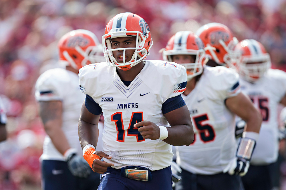 FAYETTEVILLE, AR - SEPTEMBER 5:  Kavika Johnson #14 of the UTEP Miners jogs off the field during a game against the Arkansas Razorbacks at Razorback Stadium on September 5, 2015 in Fayetteville, Arkansas.  The Razorbacks defeated the Miners 48-13.  (Photo by Wesley Hitt/Getty Images) *** Local Caption *** Kavika Johnson