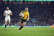 Australia's fly half Bernard Foley finding a hole in Englands defence during the Rugby World Cup Pool A match between England and Australia at Twickenham, Richmond, United Kingdom on 3 October 2015. Photo by Matthew Redman.
