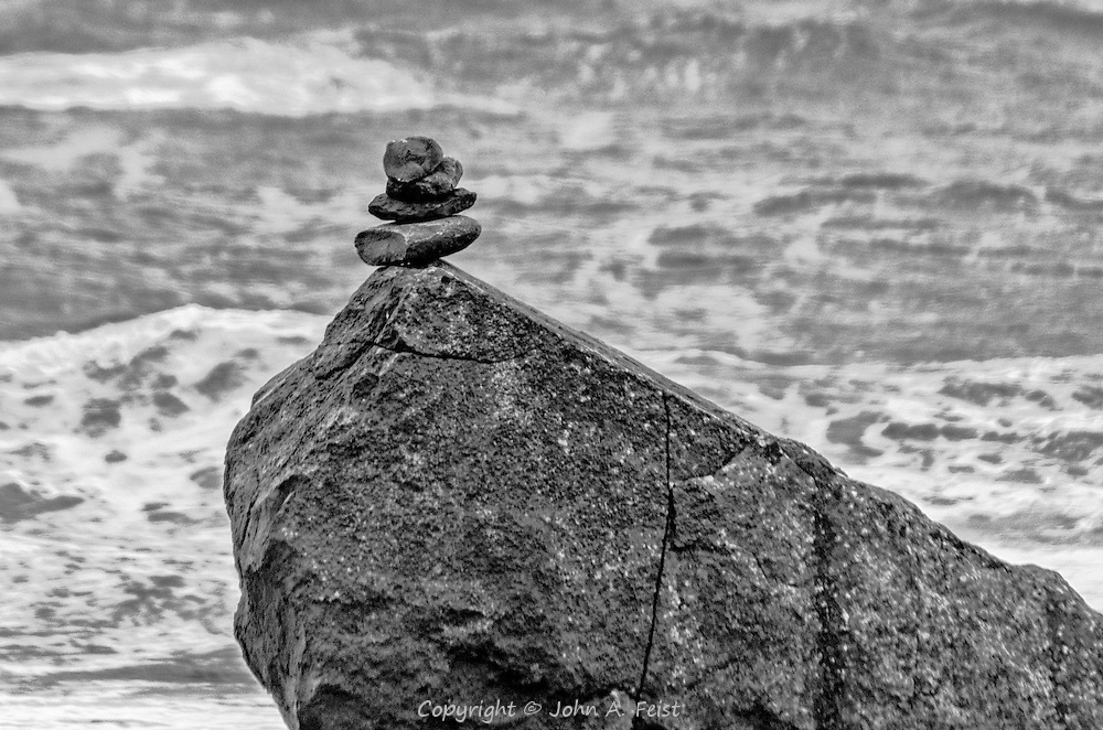 This little rock pile is just across from the base of the Cliffs of Moher in County Clare, Ireland.  When we were there, the winds were howling.  You can see how rough the seas were.  This little rock pile caught my interest as it resisted all that wind.