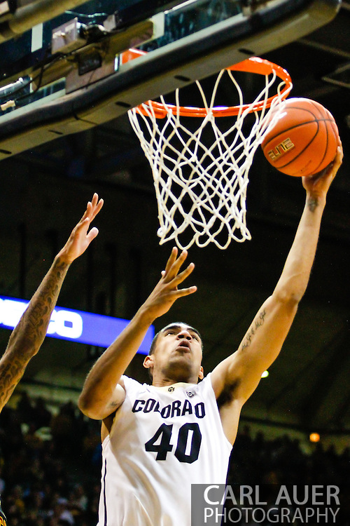 January 18th, 2014:  Colorado Buffaloes sophomore forward Josh Scott (40) slices to the basket for a shot in the second half of the NCAA Basketball game between the USC Trojans and the University of Colorado Buffaloes at the Coors Events Center in Boulder, Colorado