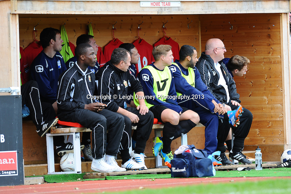 AFC Hornchurch substitutes and coaches look on from the bench. AFC Hornchurch v Wealdstone at The Stadium, Bridge Avenue, Upminster, Essex. FA Cup 3rd Qualifying Round. 12th October 2013. © Leigh Dawney Photography 2013.