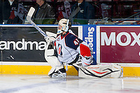 KELOWNA, CANADA - NOVEMBER 30: Taran Kozun G #41 of the Kamloops Blazers stretches on the ice during warm up against the Kelowna Rockets on November 30, 2013 at Prospera Place in Kelowna, British Columbia, Canada.   (Photo by Marissa Baecker/Shoot the Breeze)  ***  Local Caption  ***