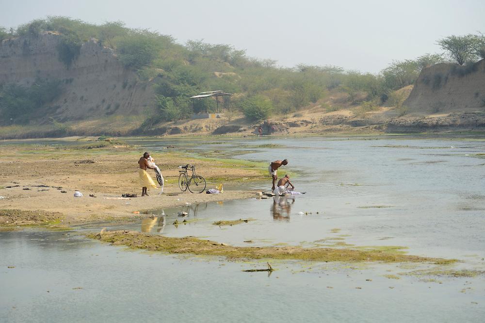 Man bathing in river near ,City of Bundi, Rajasthan,India,Asia