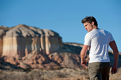 Man walking towards a New Mexico desert landform