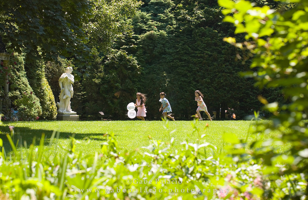 Children play near the Tapestry Hedge at Caramoor