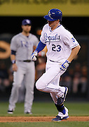 Kansas City Royals batter Elliot Johnson (23) rounds the bases after hitting a home run as Tampa Bay Rays second baseman Ben Zobrist, back, watches during the 3rd inning of a baseball game at Kauffman Stadium in Kansas City, Mo., Wednesday, May 1, 2013.  (AP Photo/Colin E. Braley).