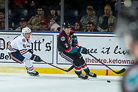 KELOWNA, CANADA - SEPTEMBER 22:  Josh Pillar #9 of the Kamloops Blazers back checks Lassi Thomson #2 of the Kelowna Rockets as he skates with the puck from behind the net on September 22, 2018 at Prospera Place in Kelowna, British Columbia, Canada.  (Photo by Marissa Baecker/Shoot the Breeze)  *** Local Caption ***
