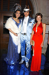 Left to right, PATTI WONG, ANDY WONG and DANNI MINOGUE at Andy & Patti Wong's annual Chinese New Year party, this year celebrating the year of the dog held at The Royal Courts of Justice, The Strand, London WC2 on 28th January 2006.<br />