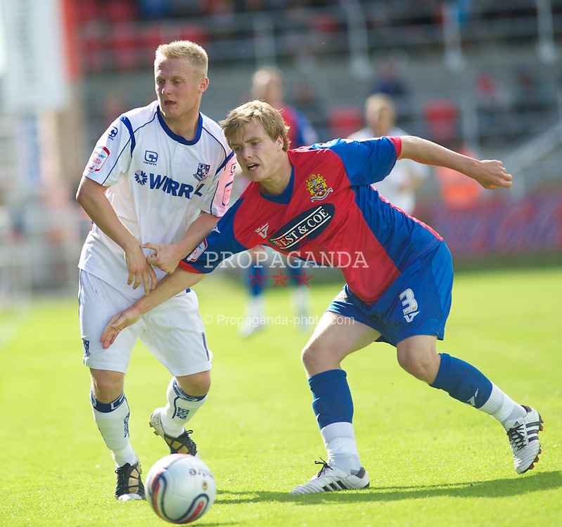 DAGENHAM, ENGLAND - Saturday, August 28, 2010: Tranmere Rovers' Ryan Fraughan and Dagenham & Redbridge Damien McCrory in action during the Football League One match at Victoria Road. (Photo by Gareth Davies/Propaganda)