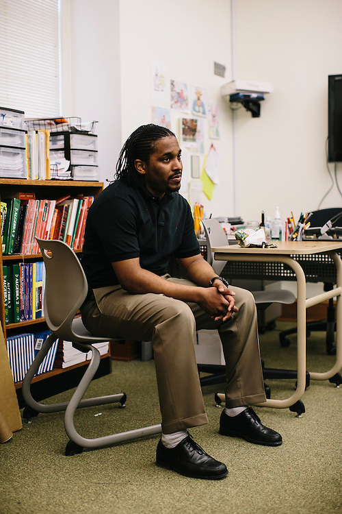 Marc Davis waits for students to arrive to his classroom at Woodrow Wilson High School in Washington DC. Davis, once worried his career path would be on the streets, mixed up with drug dealers, but after being mentored by University of Washington D.C. professor Dr. Daryao Khatri, Davis is now an algebra and geometry teacher at 23 years old.