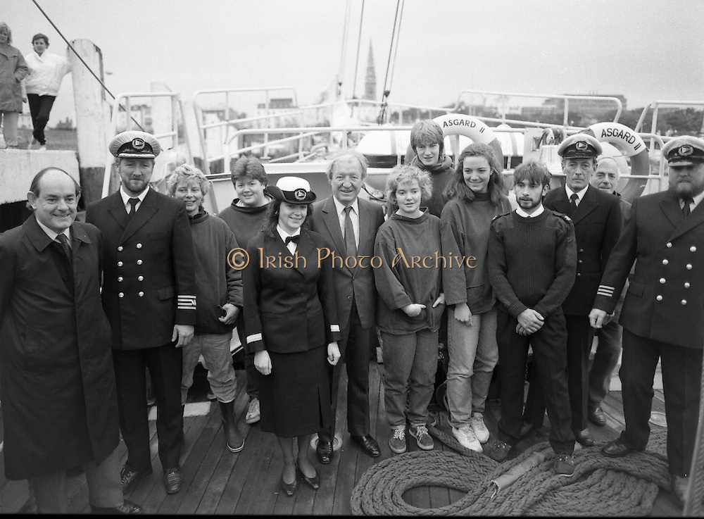 Asgard II departs for Australia.   (R66)..1987..15.10.1987..10.15.1987..15th October 1987..The Asgard II training ship departed from the National Yacht Club in Dun Laoghaire en route to Australia. The Asgard II was a purpose built training brigantine built by Jack Tyrrell in Wicklow. On hand to sent the Asgard Ii on her way was An Taoiseach, Mr Charles Haughey, and Mr Frank Milne the Australian Ambassador to Ireland...Image shows An Taoiseach, Mr Charles Haughey TD, His Excellency Mr Frank Milne, Australian Ambassador,(left) Captain Tom McCarthy (2nd left) and other members of the Asgard II crew, including Mr Frank Traynor, Mate, Mr Barry Martin, Bosun and Marie Ní Mhurchú, Catering Officer (5th from left).