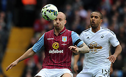 Aston Villa's Alan Hutton is tackled by Swansea City's Wayne Routledge - Photo mandatory by-line: Harry Trump/JMP - Mobile: 07966 386802 - 21/03/15 - SPORT - FOOTBALL - Barclays Premier League - Aston Villa v Swansea City - Villa Park, Birmingham, England.