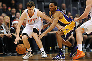 Dec 23, 2013; Phoenix, AZ, USA; Phoenix Suns guard Goran Dragic (1) handles the ball against the Los Angeles Lakers guard Wesley Johnson (11) at US Airways Center. The Suns won 117-90. Mandatory Credit: Jennifer Stewart-USA TODAY Sports