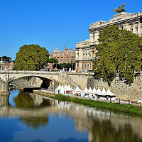 Ponte Umberto and Palace of Justice in Rome, Italy<br /> The Ponte Umberto is a three-arched stone bridge that stretches 344 feet over the River Tiber.  It was designed by Angelo Vescovali and named after Italy&rsquo;s King Umberto I who was present during the opening ceremony in 1895.  On the right is the Palace of Justice.