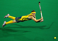 SPORT<br /> Paul Kane<br /> Getty Images<br /> <br /> Matthew Swann of Australia dives for the ball during the match between Australia and Pakistan on day one of the International Superseries.