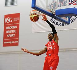 Bristol Flyers' Bree Perine slam dunks the ball - Photo mandatory by-line: Dougie Allward/JMP - Mobile: 07966 386802 - 27/02/2015 - SPORT - basketball - Bristol - SGS Wise Campus - Bristol Flyers v Leeds Force - British Basketball League