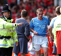 Fotball<br /> Foto: Fotosports/Digitalsport<br /> NORWAY ONLY<br /> <br /> LIVERPOOL V MANCHESTER CITY <br /> <br /> PREMIER LEAGUE 21/08/2004<br /> <br /> RICHARD DUNNE (MANCHESTER CITY) IS SHOWN THE EXIT BY A POLICEMAN AFTER CONTROVERSIAL SENDING OFF BY REFEREE GRAHAM POLL