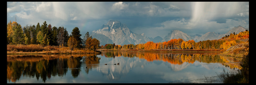 Fall foliage at Oxbow Bend in Grand Teton National Park with changing clouds and reflections.