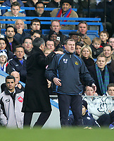 Photo: Lee Earle.<br /> Chelsea v Wigan Athletic. The Barclays Premiership.<br /> 10/12/2005. Chelsea manager Jose Mourinho (L) gives Wigan boss Paul Jewell a tap on the back.