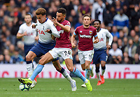 Football - 2018 / 2019 Premier League - Tottenham Hotspur vs. West Ham United<br /> <br /> Tottenham Hotspur's Dele Alli battles for possession with West Ham United's Ryan Fredericks, at The Tottenham Hotspur Stadium.<br /> <br /> COLORSPORT/ASHLEY WESTERN