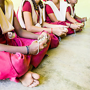 Crimson, Chennai, India by Kushboo.<br /> <br /> A special angle shot of four girls from the Government Girls School at Perambur, Chennai, India, as they sit and wait for their first photography lesson to start.