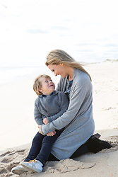mother and little boy together on the beach