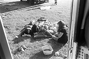 Young girls chatting laying in the sun,Glastonbury, 1995.