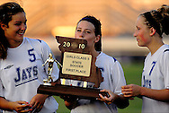 5 JUNE 2010 -- FENTON, Mo. -- Liberty High School's Brooke Williams (6) kisses the state championship trophy after was was presented to Liberty following the Class 3 championship game at the MSHSAA girls' soccer tournament Saturday, June 5, 2010 at the Anheuser-Busch Center in Fenton, Mo. Photo © copyright 2010 by Sid Hastings.