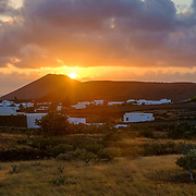 The sun is setting down on the city of Yaiza, Lanzarote.