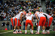 Sept. 4, 2010; Akron, OH, USA; Syracuse Orange quarterback Ryan Nassib (12) in the huddle with his team during the first quarter against the Akron Zips at InfoCision Stadium. Mandatory Credit: Jason Miller-US PRESSWIRE