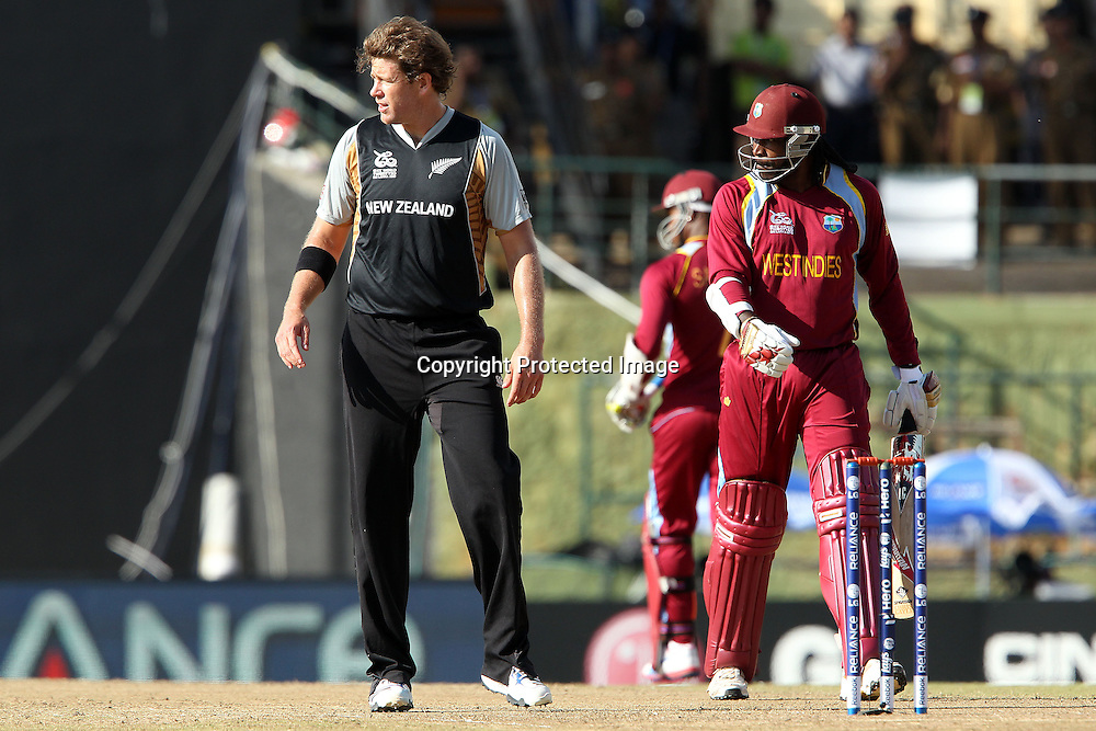 Jacob Oram walks bask as Chris Gayle of The West Indies and Marlon Samuels of The West Indies make the run during the ICC World Twenty20 Super Eights match between The West Indies and New Zealand held at the  Pallekele Stadium in Kandy, Sri Lanka on the 1st October 2012<br /> <br /> Photo by Ron Gaunt/SPORTZPICS/PHOTOSPORT