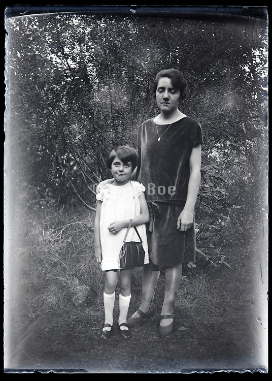 mother with child standing in nature setting France circa 1920s