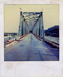 Perspective of a metallic bridge crossing over a river, Norhtern Vietnam, Southeast Asia