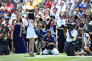 LOS ANGELES, CA - JULY 28:  Tiffany of the Korean pop girls group Girls Generation sings the National Anthem before the Los Angeles Dodgers game against the Cincinnati Reds on Sunday, July 28, 2013 at Dodger Stadium in Los Angeles, California. The Dodgers won the game in a 1-0 shutout. (Photo by Paul Spinelli/MLB Photos via Getty Images) *** Local Caption *** Tiffany