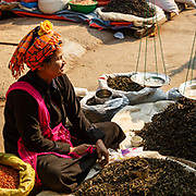 Local Intha lady selling loose tea in Nyuang Shwe market