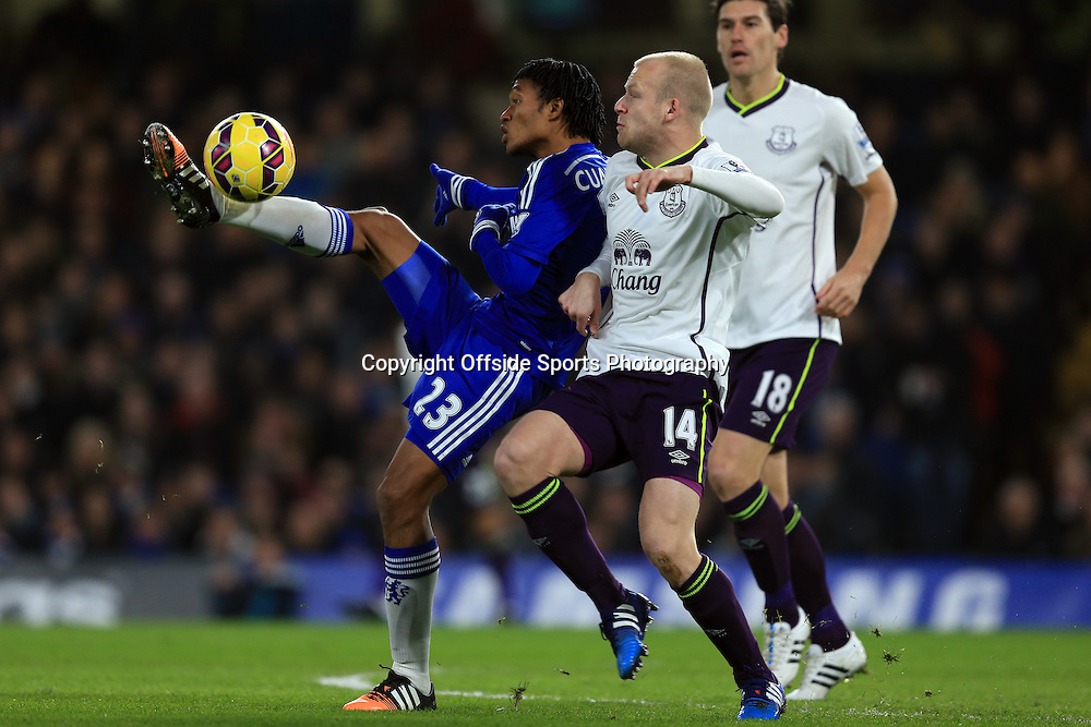11 February 2015 - Barclays Premier League - Chelsea v Everton - Juan Cuadrado of Chelsea tangles with Steven Naismith and Gareth Barry of Everton- Photo: Marc Atkins / Offside.