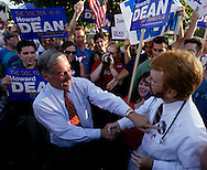Democratic presidential hopeful and former Vermont Gov. Howard Dean, left, points to Eric Davis, right, as he greets supporters upon arriving at the AFL-CIO presidential forum, Tuesday, Aug. 5, 2003, in Chicago. Dean is one of nine Democratic presidential hopefuls participating in the forum. (AP)