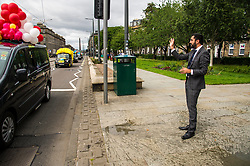 Pictured: Humza Yousef caught caught up in the fun of the annual taxi drivers charity trip to the seaside with the youngsters not standing on ceremony and soack the minister with water bombs and water pistols<br /> <br /> Transport Minister Humza Yousaf launched the second phase of Switched on Scotland when he visited J &amp; E Shepherd Chartered Surveyors today.  During the visit Mr Yousaf saw how the business is benefiting from adopting electric vehicles via the Low Carbon Transport Loan Fund, as he announced an additional GBP8.2 million to support the purchase of low-carbon vehicles. <br /> <br /> Ger Harley | EEm 13 June  2017