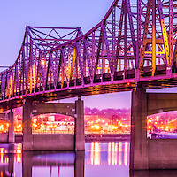 Peoria Illinois Bridge at Night Panorama Photo. The Murray Baker Bridge spans the Illinois River connecting Peoria with East Peoria as Interstate I-74. Built in 1958, the bridge is named after Murray Baker who started a company that would later become Caterpillar. Panorama photo ratio is 1:3.