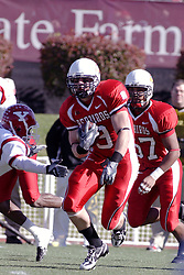 28 October 2006:Tom Nelson makes a cut to avoid the Penguin defenders. Youngstown State turned off over 15,000 fans as the win blew their way, cooling off Illinois State 27-13. Nationally ranked teams Youngstown State Penguins and Illinois State Redbirds competed at Hancock Stadium on the campus of Illinois State University in Normal Illinois.<br />