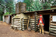 A sentry in front of the captain's quarters at Fort Clatsop (Lewis & Clark's 1805-1806 winter post), Fort Clatsop National Memorial, Astoria, Oregon