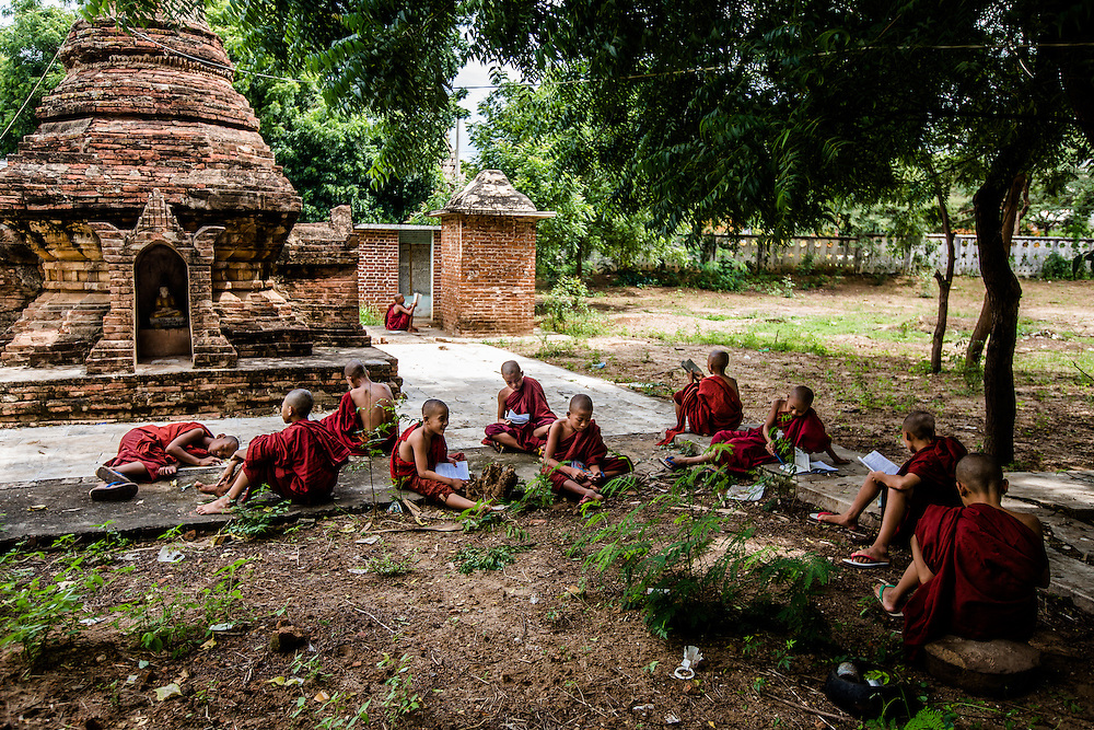 Novice monks study on the grounds of their monestary, Bagan, Myanmar
