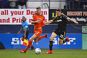 Luton Town player Jack Stacey fights for the ball in the box in the first half during the EFL Sky Bet League 1 match between Luton Town and AFC Wimbledon at Kenilworth Road, Luton, England on 23 April 2019.