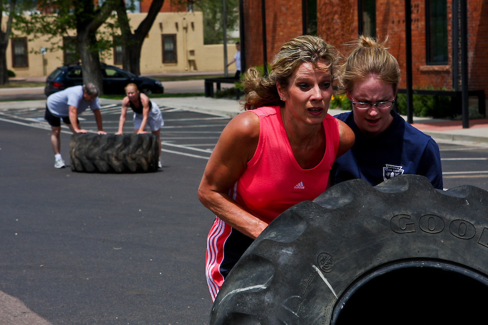 Kira and Kaye flip tires at CrossFit SoCo. Crossfit image, picture, photo, photography of health, elite, exercise, training, workouts, WODs, taken at Progressive Fitness CrossFit,Colorado Springs, Colorado, USA