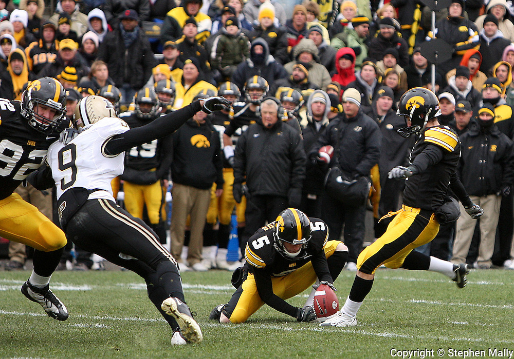 15 NOVEMBER 2008: Iowa kicker Daniel Murray (1) kicks 45 yard field goal from the hold of Iowa's Ryan Donahue (5) in the second half of an NCAA college football game against Purdue, at Kinnick Stadium in Iowa City, Iowa on Saturday Nov. 15, 2008. Iowa beat Purdue 22-17.