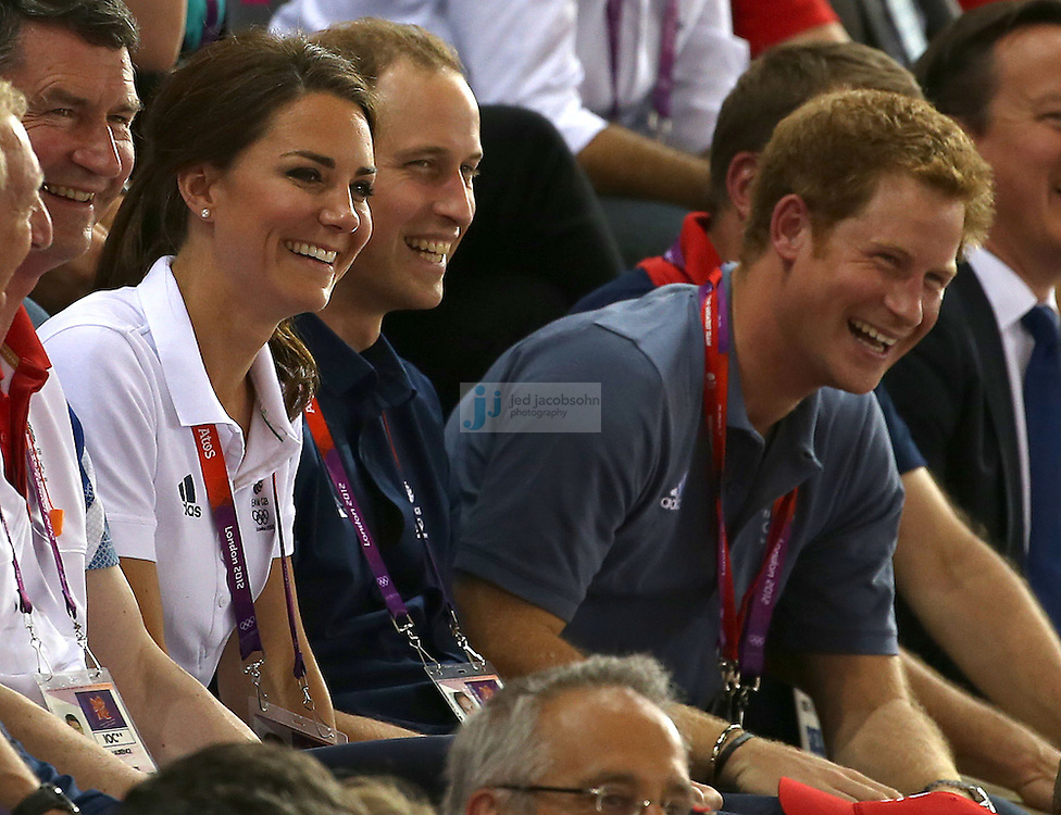 Catherine, Duchess of Cambridge, Prince William, Duke of Cambridge and Prince Harry look on during the men's cycling sprint finals at the velodrome during day 6 of the London Olympic Games in London, England, United Kingdom on August 2, 2012..(Jed Jacobsohn/for The New York Times)..