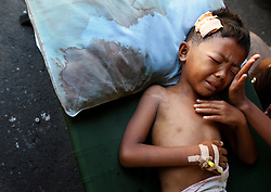 Eleven-year-old Indonesian injured earthquake survivor, Gonrizal  cries in pain form his injuries inside a field hospital in Padang, West Sumatra, Indonesia 02 October 2009. Rescue workers were searching Friday for survivors and bodies under the rubble of collapsed buildings in Indonesias West Sumatra as the United Nations estimated 1,100 people were killed in the massive earthquake.