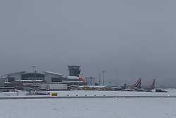 © Licensed to London News Pictures.04/03/16. Leeds, UK. Planes are grounded at Leeds Bradford Airport after heavy snowfall over night in Yorkshire. Many flights have been delayed or cancelled as the ground crews fight to clear the snow. Photo credit : Ian Hinchliffe/LNP