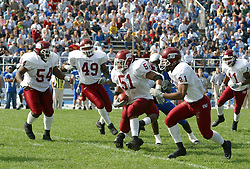 12 October 2002: Justen Rivers cuts up the middle protected by Marcus Adams, Chad Dewberry.  Eastern Illinois University Panthers host and defeat the Colonels of Eastern Kentucky during EIU's Homecoming at Charleston Illinois.